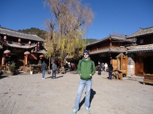 Jonny Blair in Shuhe Old Town square in China a lifestyle of travel