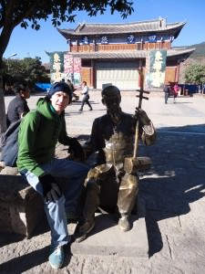 Jonny Blair at music square in Shuhe Old Town in China a lifestyle of travel