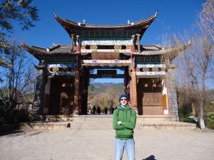 Jonny Blair at entrance to Shuhe Old Town Yunnan a lifestyle of travel