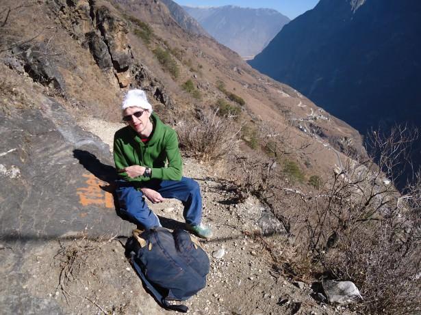 Jonny Blair at a sign for Tibet