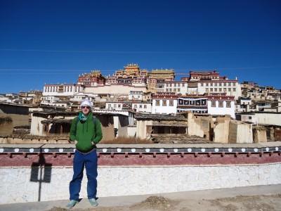 Jonny Blair at the The Ganden Sumtseling Gompa 300 year old Tibetan Monastery in Yunnan, China