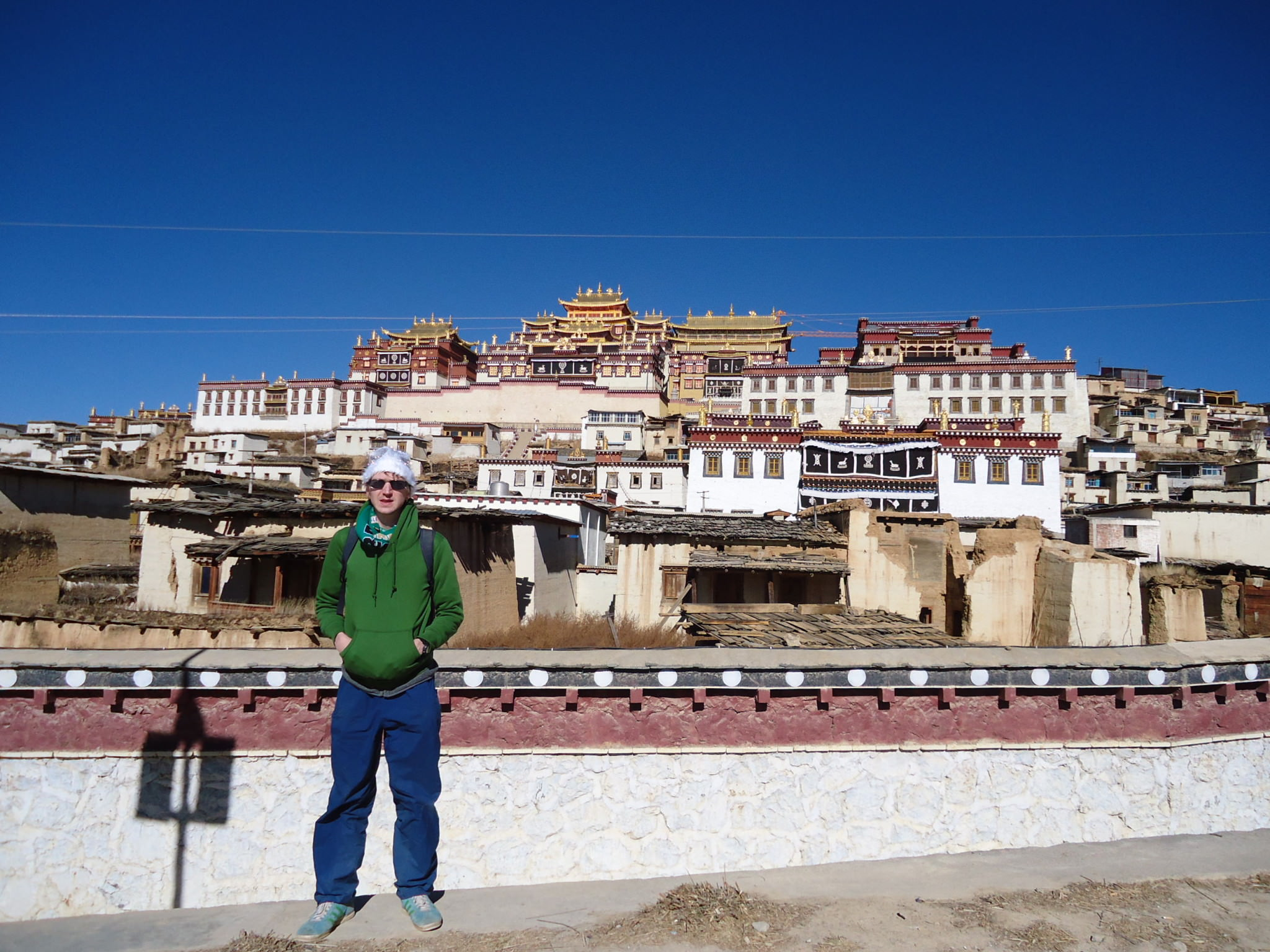 Jonny Blair at the The Ganden Sumtseling Gompa 300 year old Tibetan Monastery in Yunnan, China
