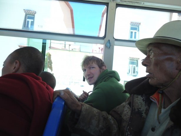 Jonny Blair on a local bus in Shangri La in Yunnan to the Ganden Sumtseling Gompa