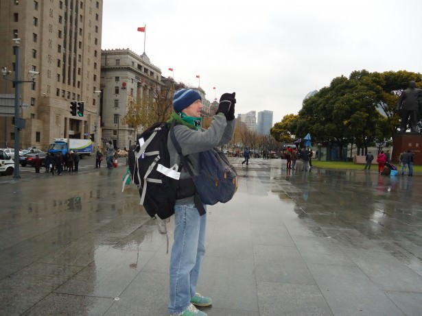 Jonny Blair taking a photo in Shanghai, CHINA. He lives a lifestyle of travel.