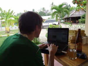 Jonny Blair writing his travel blog Don't Stop Living in Panglao Philippines
