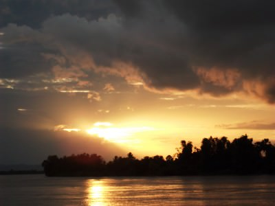 sunset in don det si phan don laos