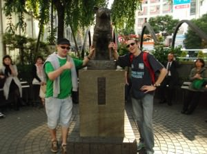 Jonny Blair at a dog statue in Shibuya Tokyo Japan living a lifestyle of travel