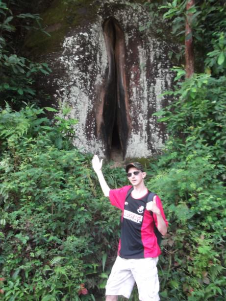 Jonny Blair at a rock shaped like a woman's private parts in China