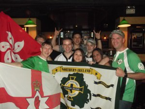 jonny blair football nomad and loves northern ireland - watching the match in 2012 with the Hong Kong NISC