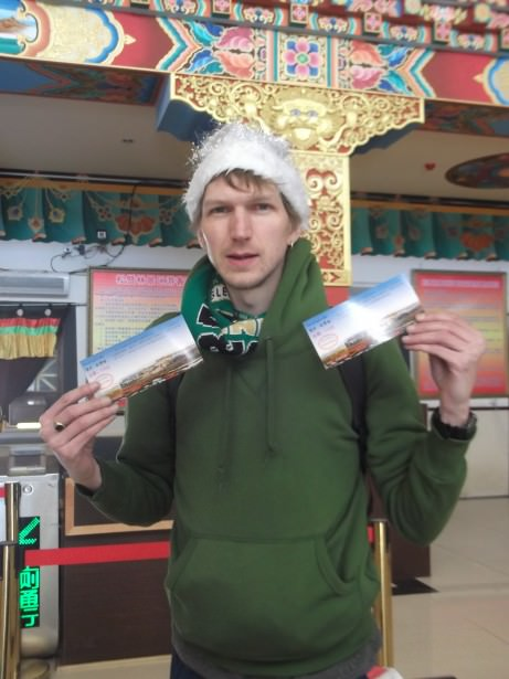 Jonny Blair with ticket for Ganden Sumtseling Gompa in Yunnan China