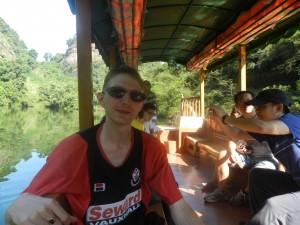 Jonny Blair on a boat at Xiang Long Lake near Vagina Rock
