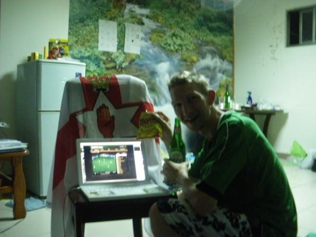 Jonny Blair keeping up to date with the Northern Ireland match in Taiwan in 2009