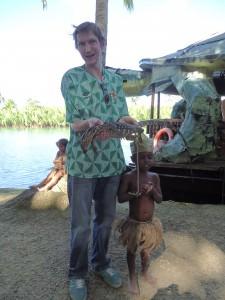 Jonny Blair holding a baby crocodile in Bohol Philippines