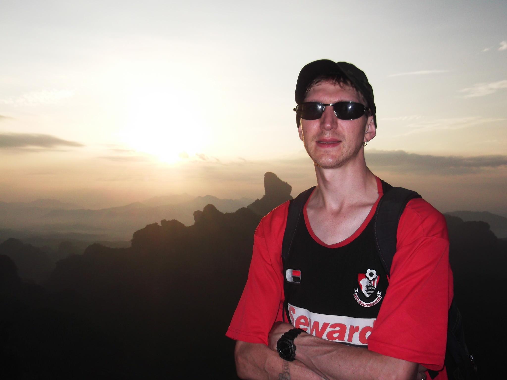 Jonny Blair enjoying sunrise at Elder Peak in China