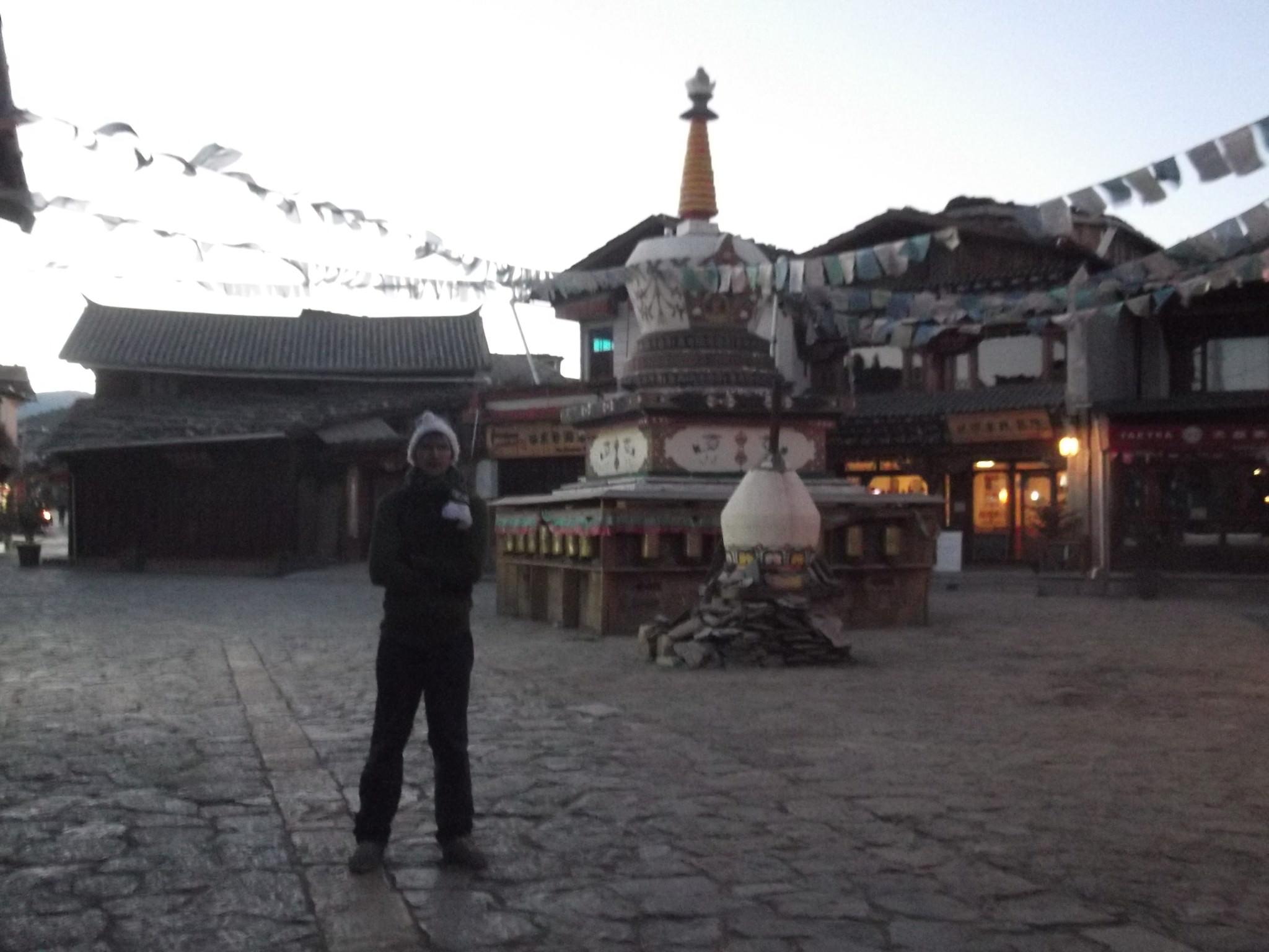 Jonny Blair at a Tibetan Stupa in Shangri La