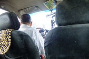 Jonny Blair in a taxi in Ecuador living a lifestyle of travel