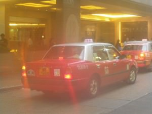 a red taxi in Hong Kong - Jonny Blair a lifestyle of travel