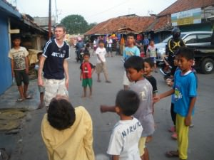 Jonny Blair playing football with the kids in Jakarta Indonesia