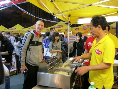 Jonny Blair eating stinky tofu in Hong Kong