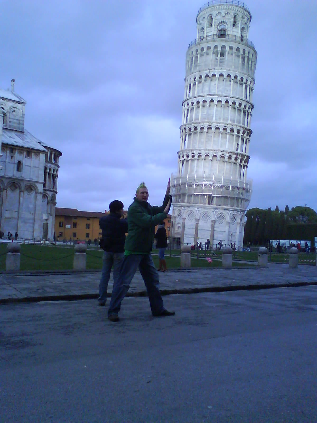 Jonny Blair pushing the leaning tower of pisa
