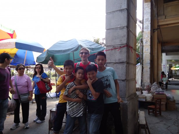 Posing with local children in Chikan, Guangdong, China