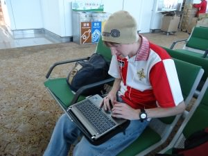 Jonny Blair of Don't Stop Living using free wi-fi at airports
