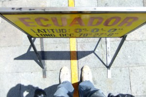 standing on the equator in Ciudad Mitad Del Mundo
