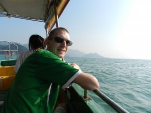 Jonny Blair on a boat at Tai O