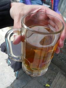 Bolivian drinks Mocochinchi in La Paz
