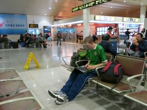 Jonny Blair typing in Shenzhen Airport