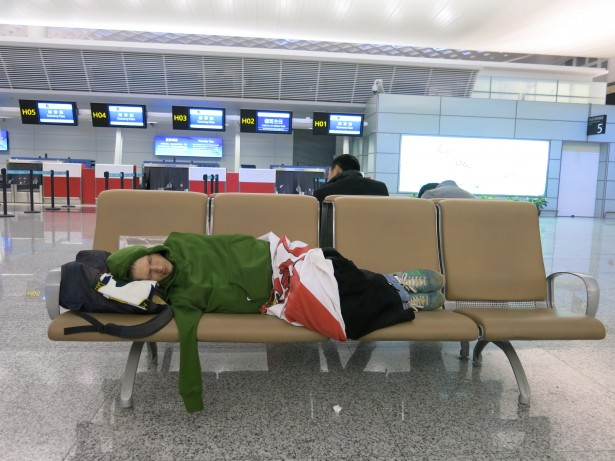 Jonny Blair sleeping in Hangzhou Airport