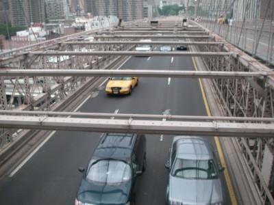Walking across Brooklyn Bridge in New York.