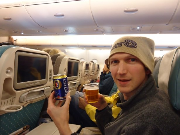 Jonny Blair with a free beer on Singapore airlines