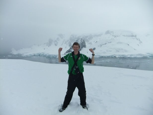 Jonny Blair in Antarctica at the top of Cuverville Island