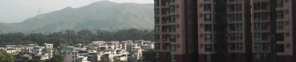 Countryside and skyscrapers in Yuen Long Hong Kong