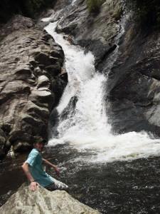 hiking in sapa at a waterfall
