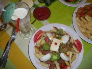 eating pique a lo macho potosi bolivia