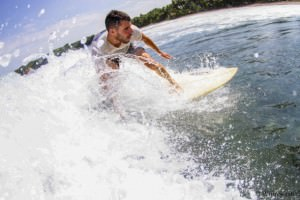 ian from borderless travels surfing in indonesia