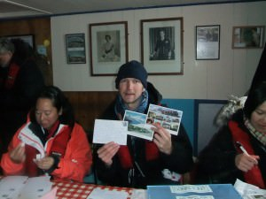 posting postcards in Antarctica