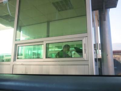armenian border guard in booth