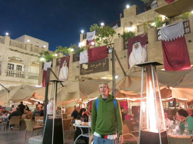 Posing by Qatar flag in Doha