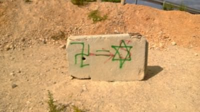Ouch! Some graffiti in Palestine compares the Israelis to Nazis.