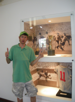 By a replica of the 1950 Jules Rimet trophy.
