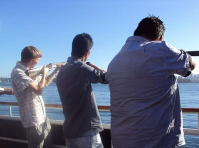 Staff night out on a boat cruise shooting pigeons.