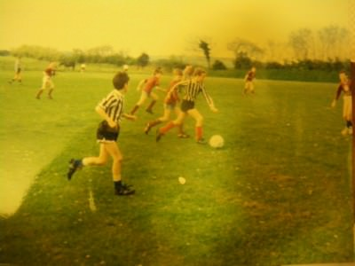 A photo of me playing football aged 11 (I'm the guy chasing the player on the ball. I went un-noticed.