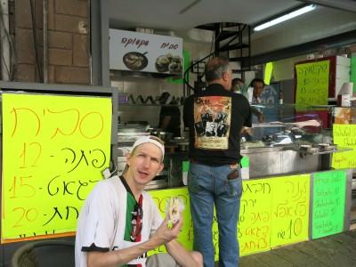 Munching Falafel in Jaffa Market, Israel.