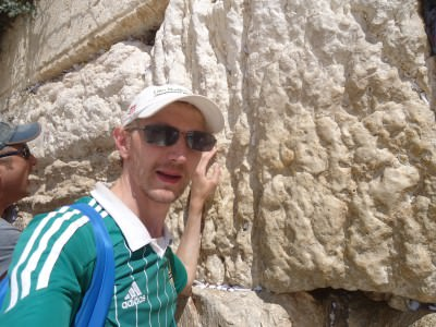 "Touching the ""Wailing Wall"" in Jerusalem."