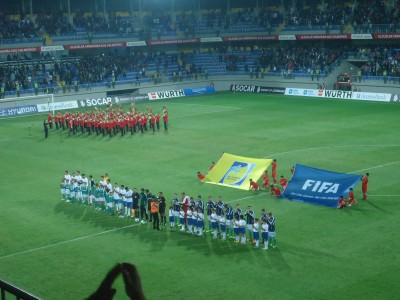 The teams line up in Baku.