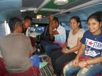 In the back of a microlet in Dili - 25 cents a ride.