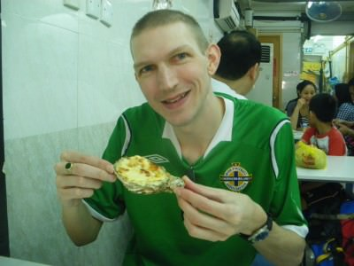 Eating cheese oysters in Tai O, Hong Kong.